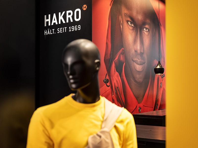 Hakro booth with a mannequin wearing a yellow shirt